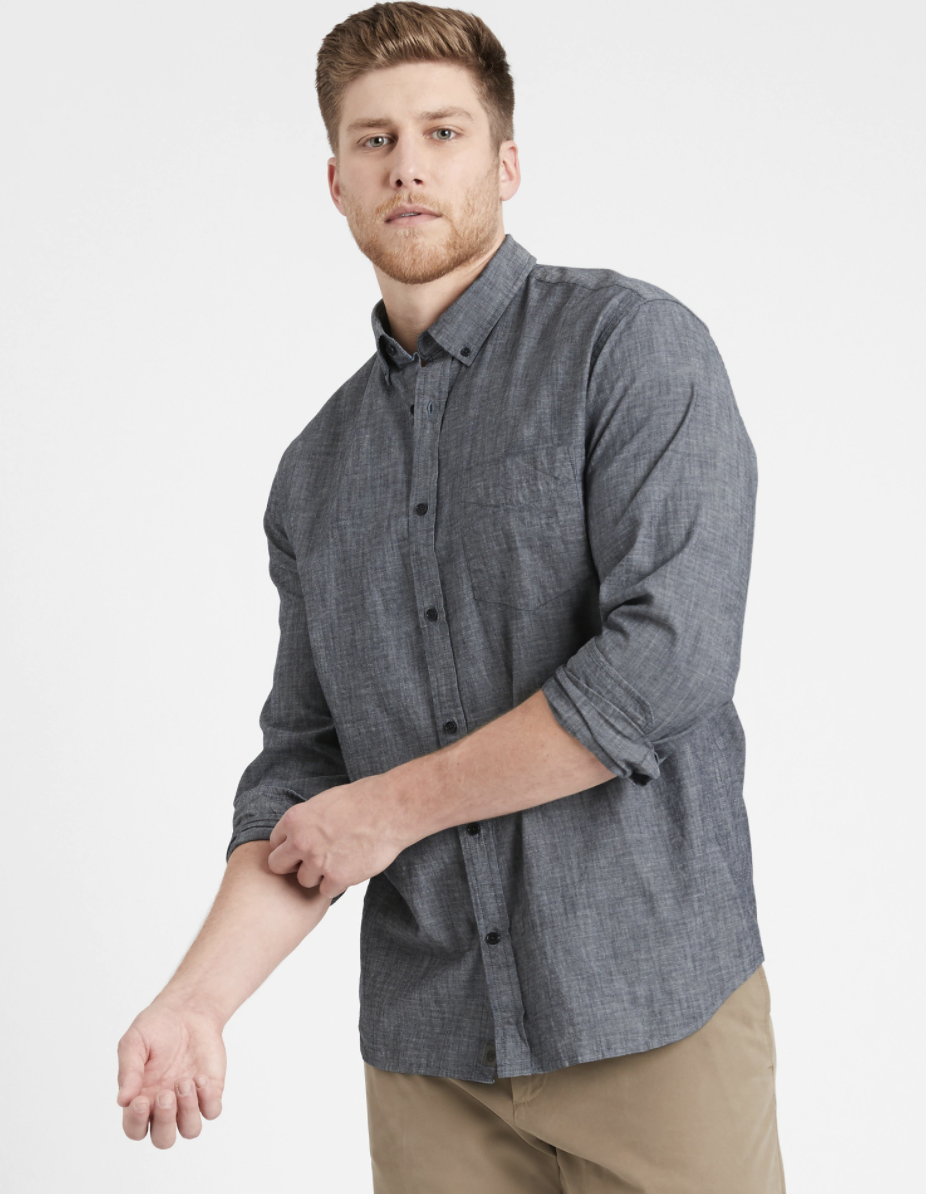 Model wearing untucked slim-fit chambray shirt in the shade medium wash