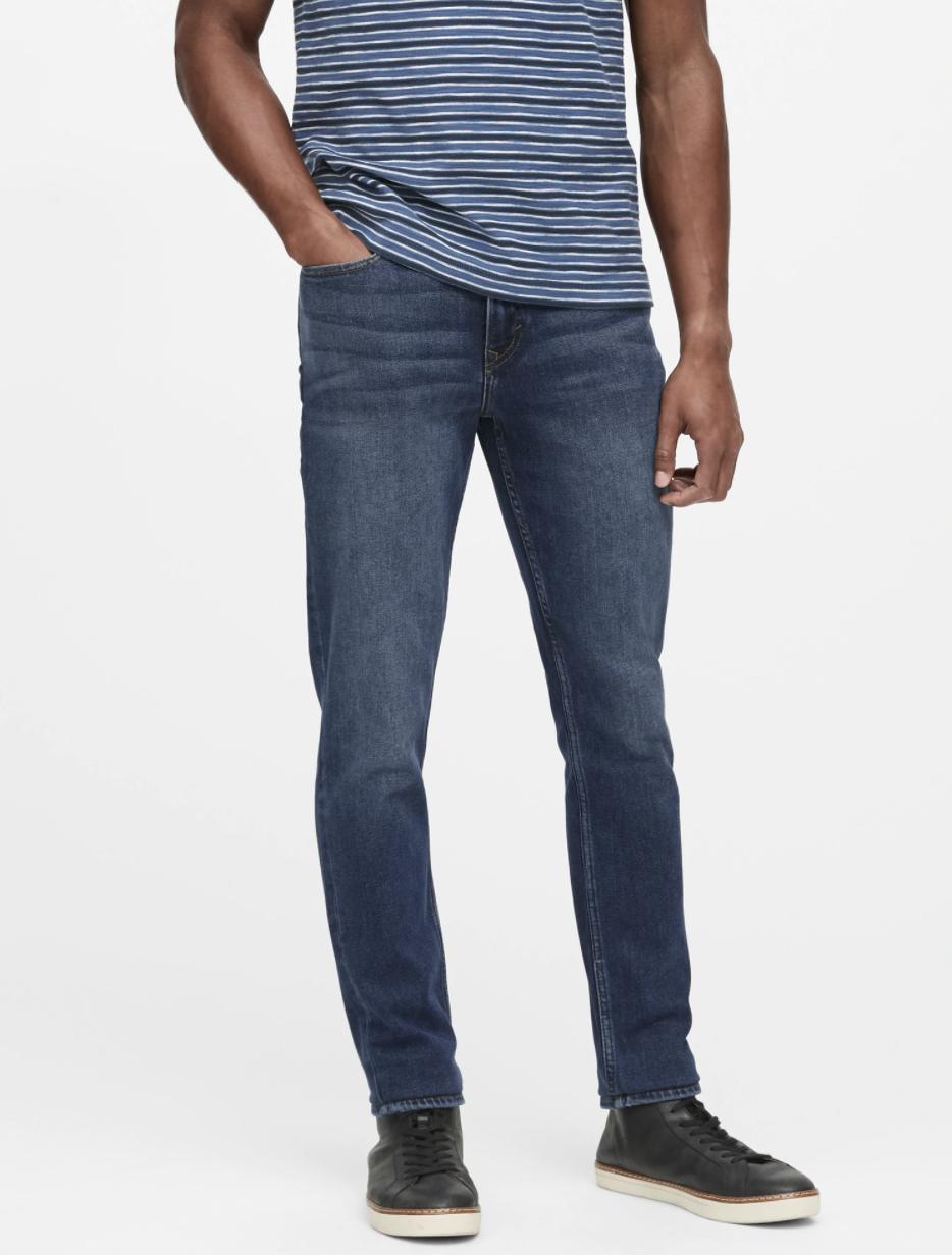 Model wearing slim legacy jean in the shade medium wash