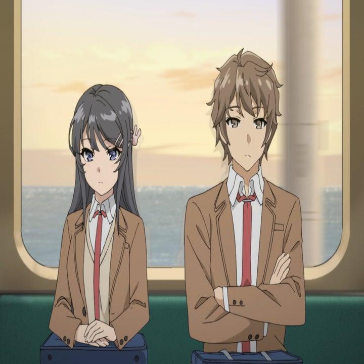 Sakuta Azusagawa and Mai Sakurajima sitting next to each other on a train