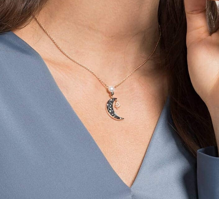 Model wearing the crescent moon pendant