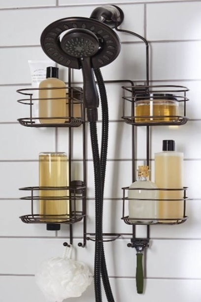 bronze shower caddy with various bottles