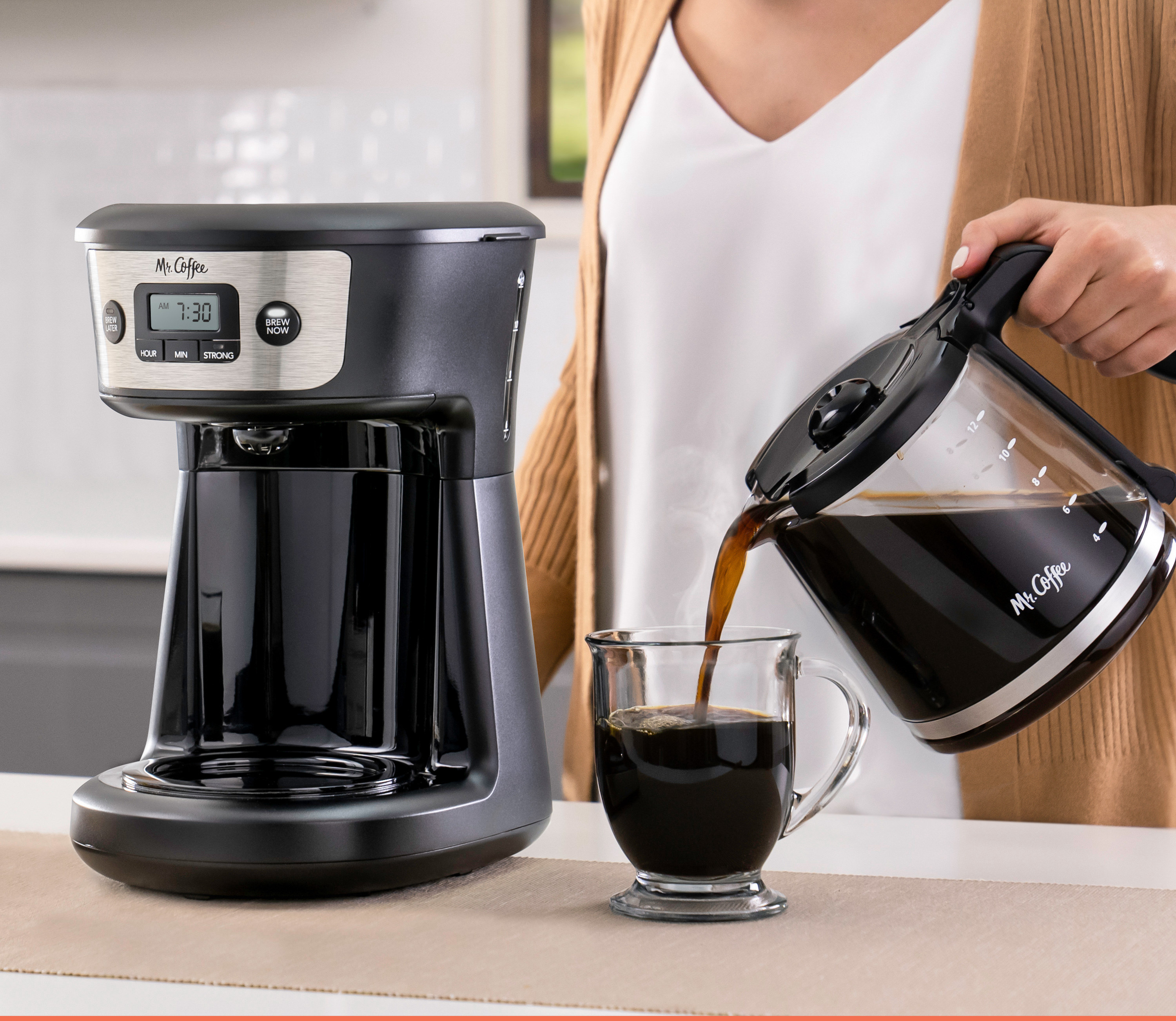 coffee maker on counter and woman pouring coffee from pot