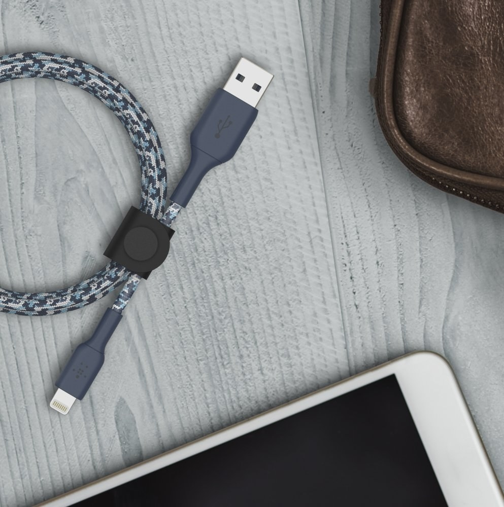 lightning cable cord sitting on table next to phone