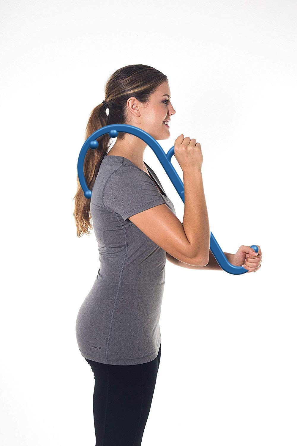 woman using a neck and back massager cane on upper back