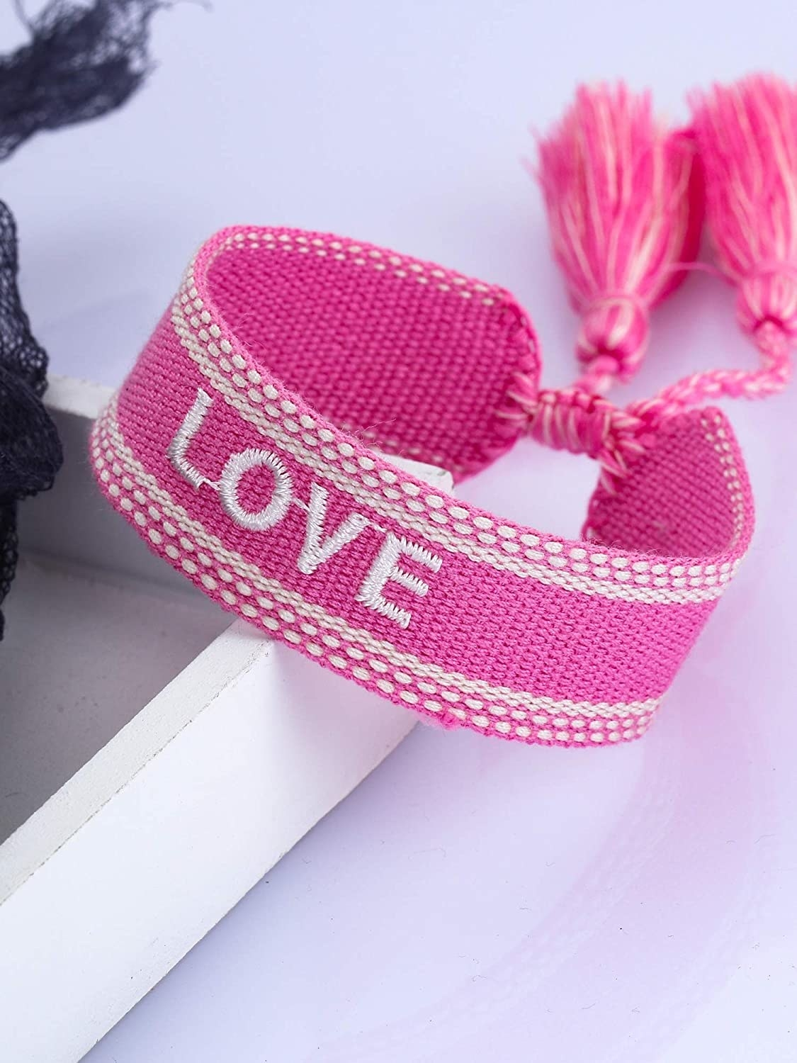 Pink and white woven bracelet with LOVE embroidery