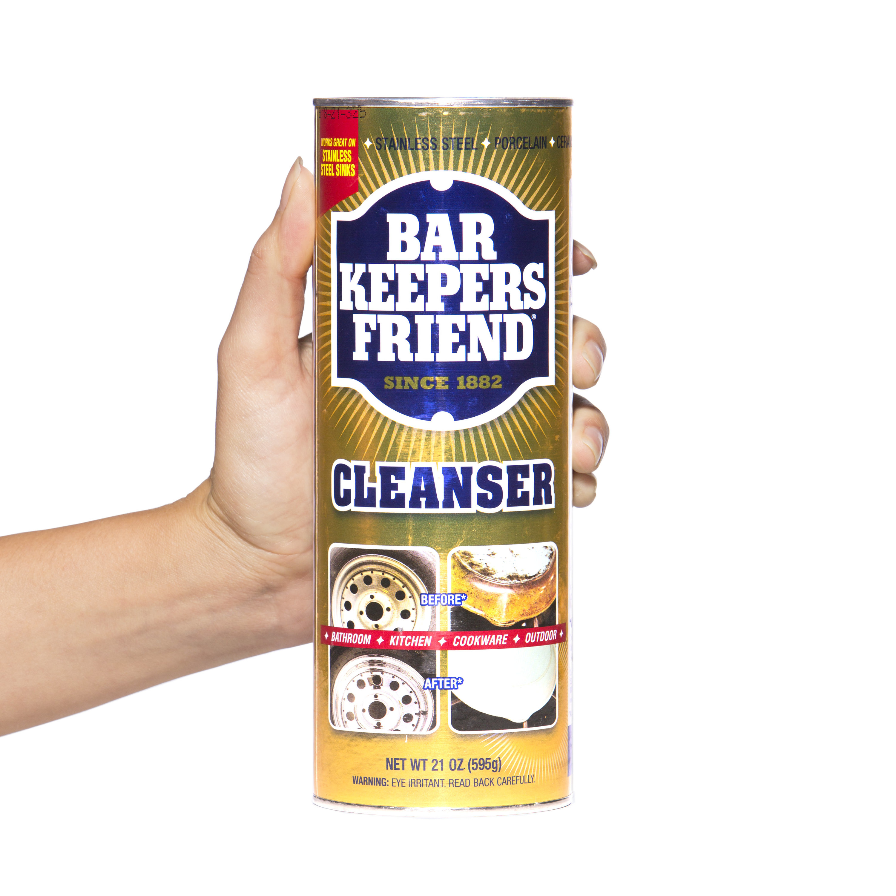 hand holding canister of bar keepers friend cleanser