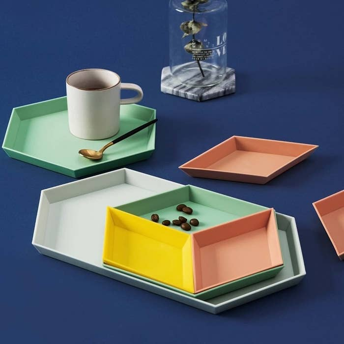 the full set of trays holding a mug and a few coffee beans