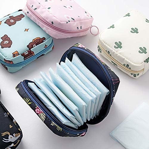 A patterned blue pouch filled with sanitary pads.