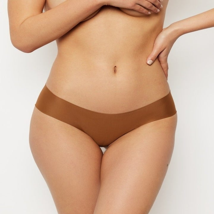 model in seamless brown low-rise underwear