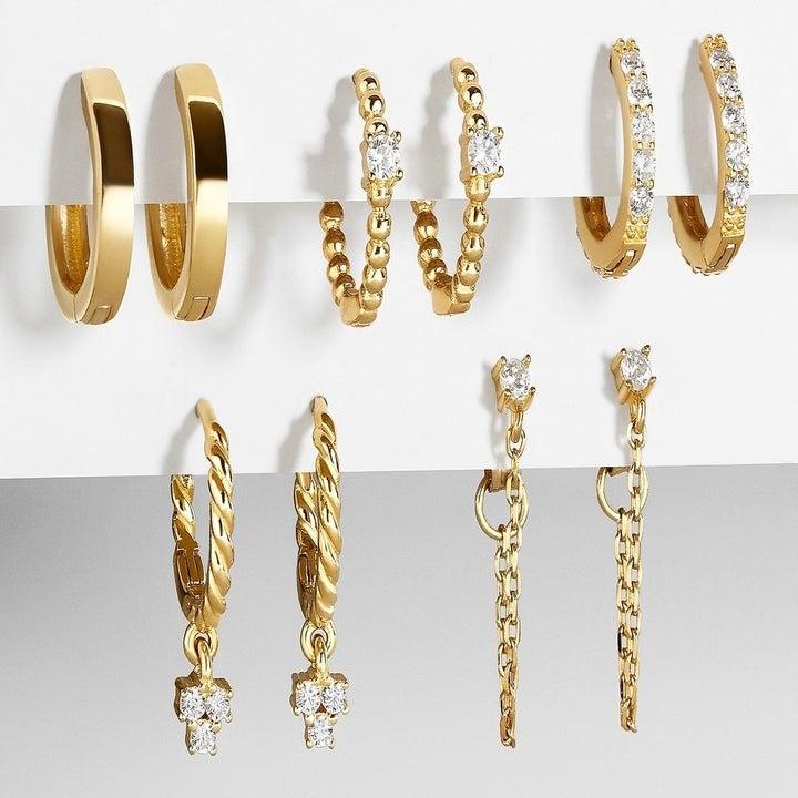 the set of five huggie hoop earrings