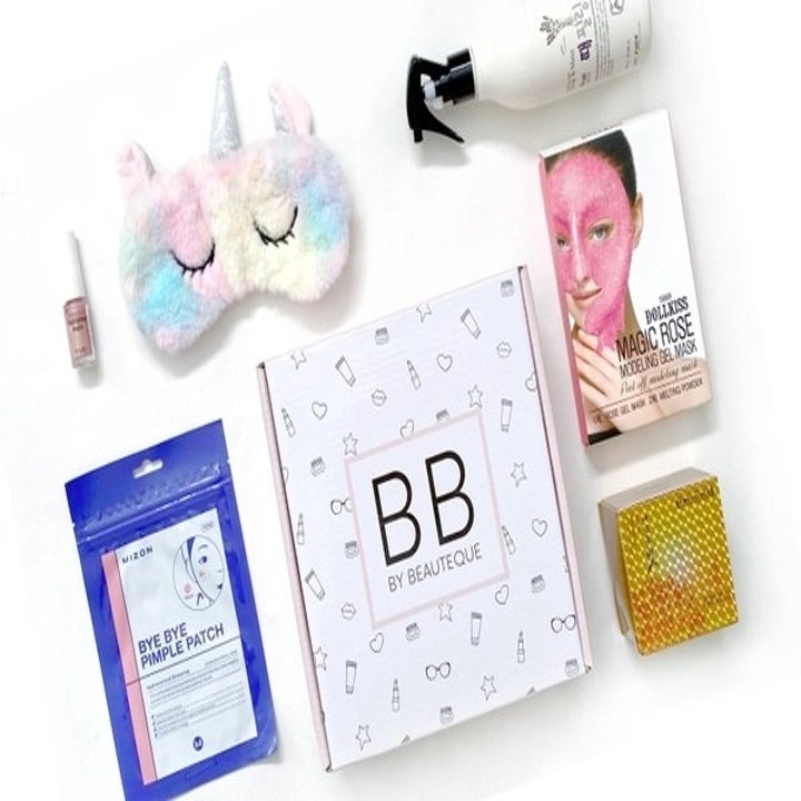 various products including a face mask, pimple patches, and a unicorn eye mask