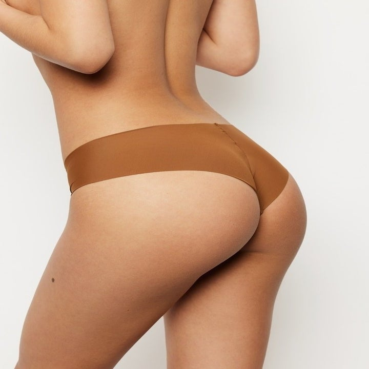 back of model with cheeky cut showing