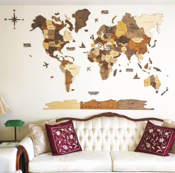 The wooden 3D map on a wall above a couch