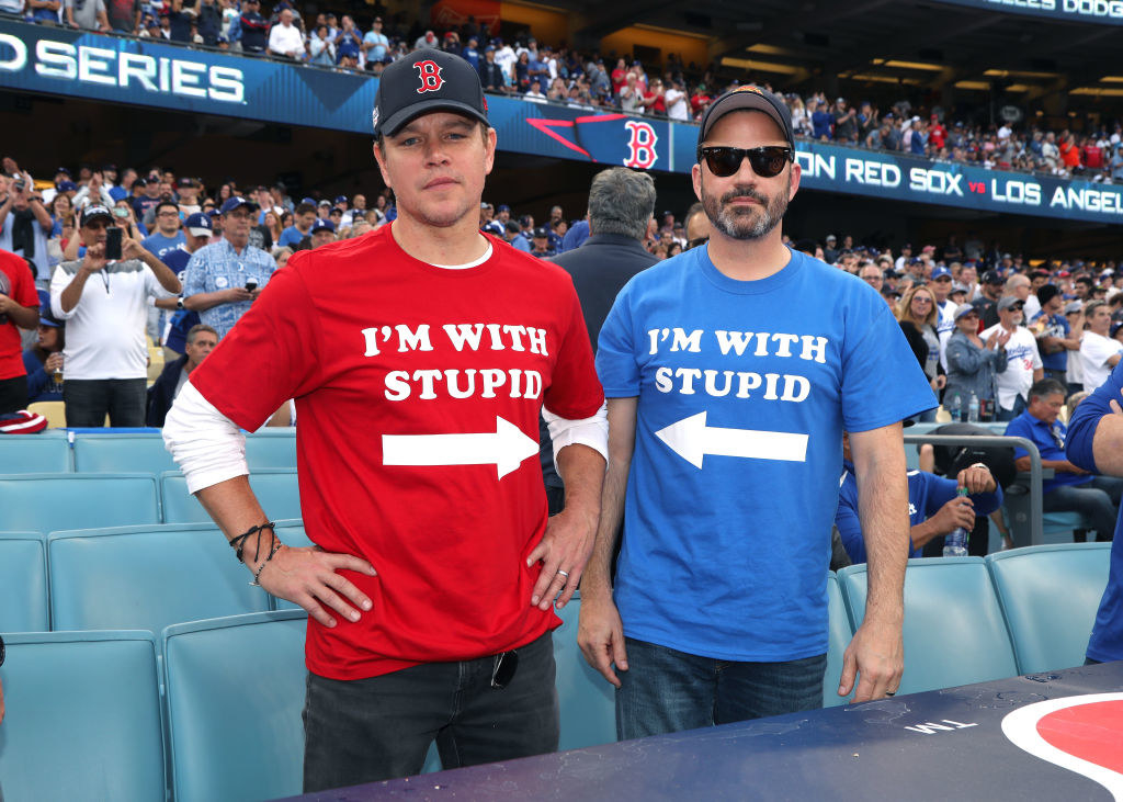"""Matt Damon and Jimmy Kimmel wearing matching t-shirts that read """"I'm with stupid"""" at a Red Sox game in the late 2010s"""