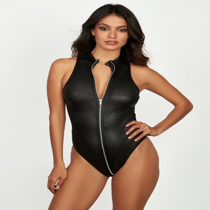 model wearing faux leather zip up body suit