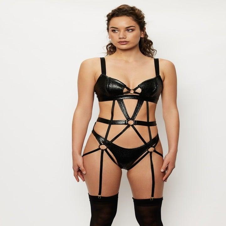 model in strapping bondage-inspired teddy