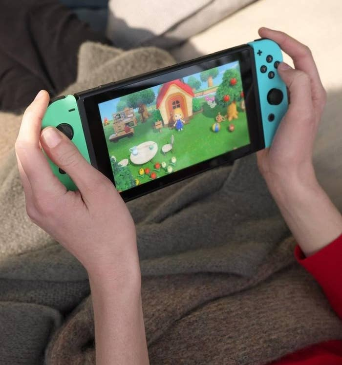A person playing Animal Crossing on their Switch