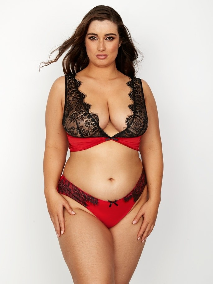 plus size model wearing plunging lace-accent bralette that's more about aesthetics than support