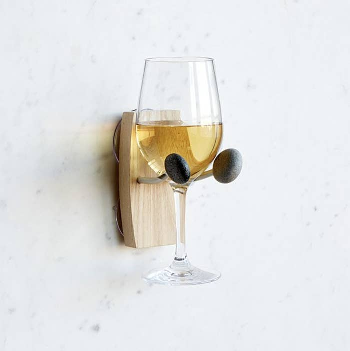 A glass of wine on a mounted cup holder