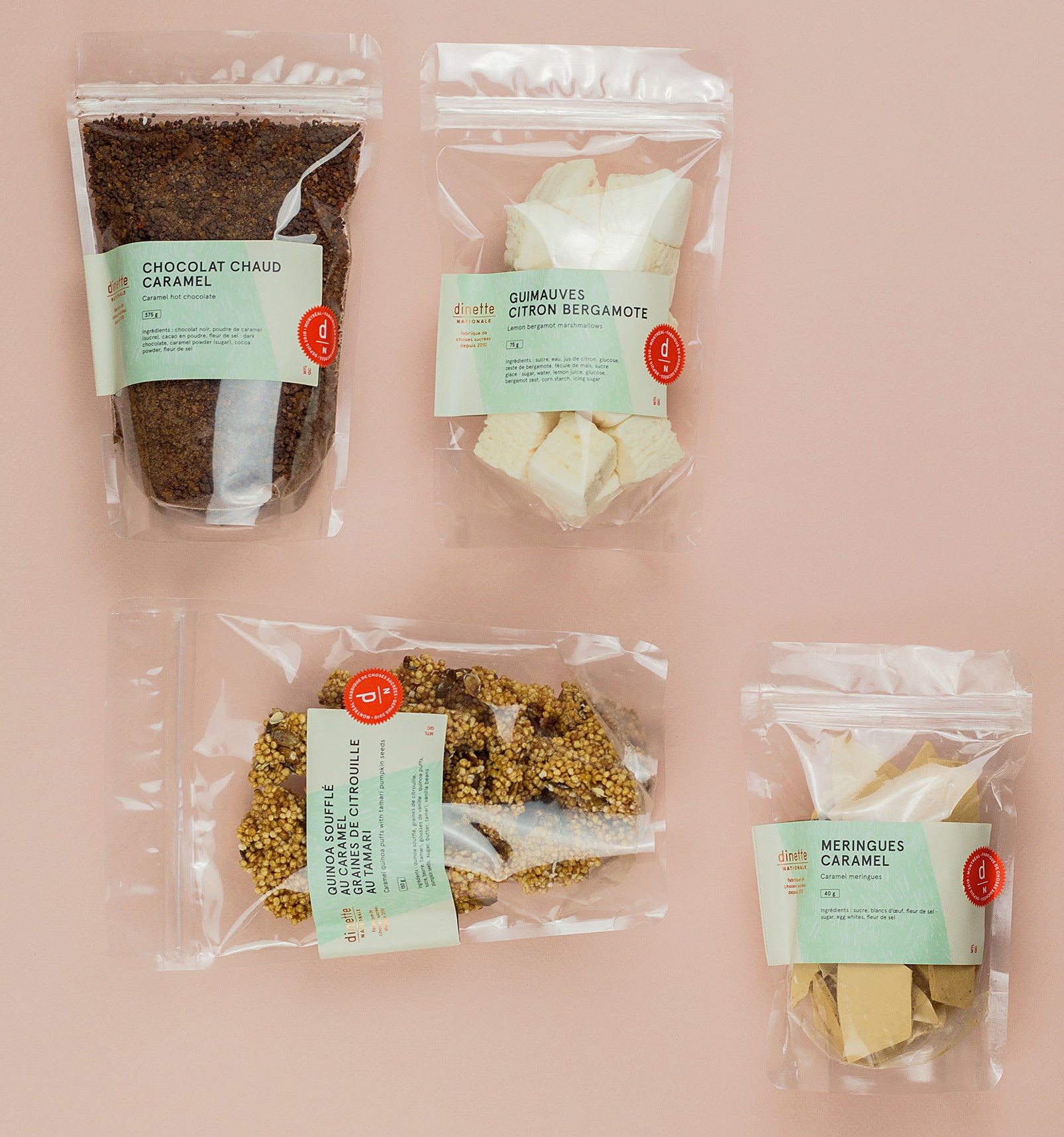 Four packages of food on a plain background