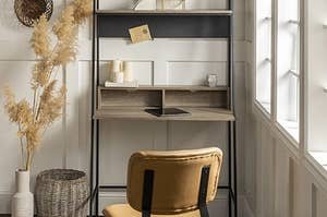 Metal desk frame with manufactured wood desktop and shelving