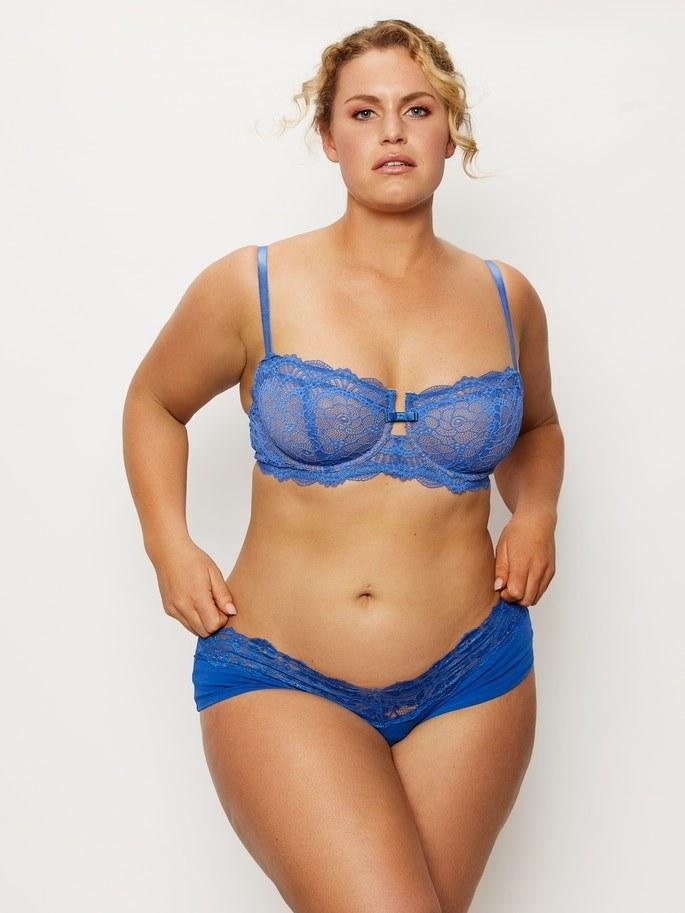plus size model wearing blue lace balconette push up bra