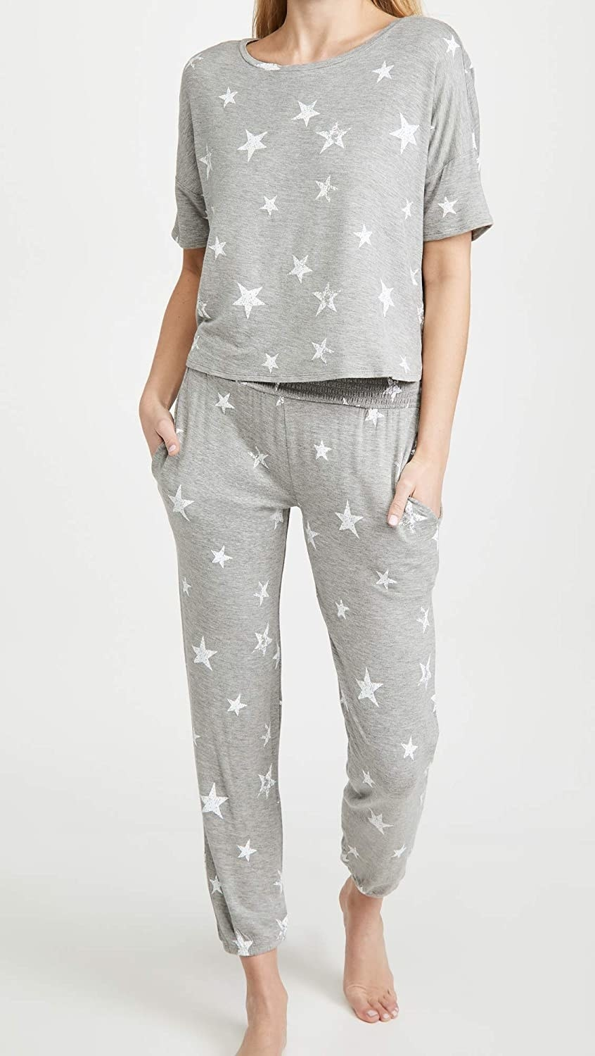 Model wearing grey set with white stars