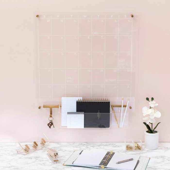 Clear acrylic wall calendar with gold hardware