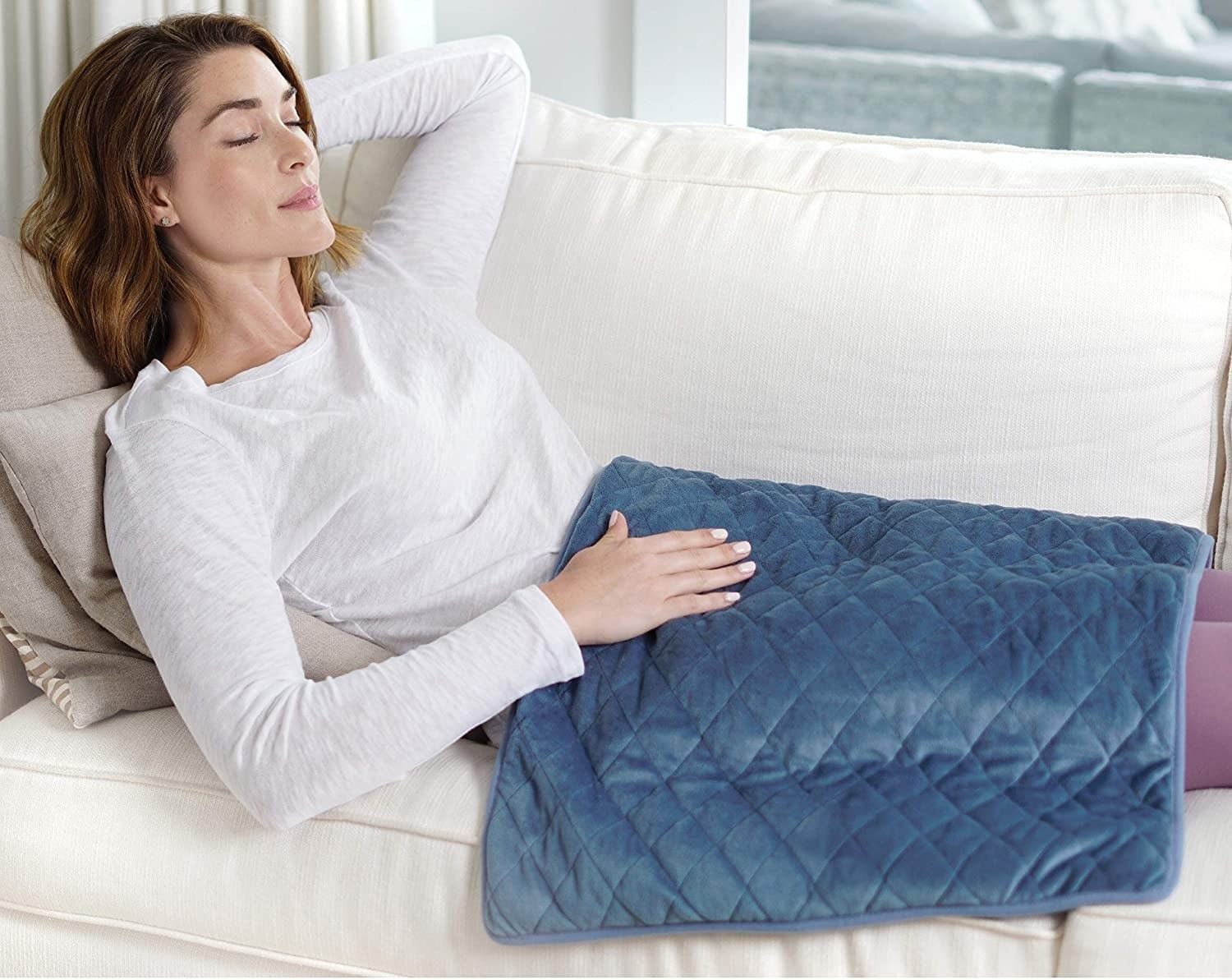 The pad spread on top of a sleeping woman