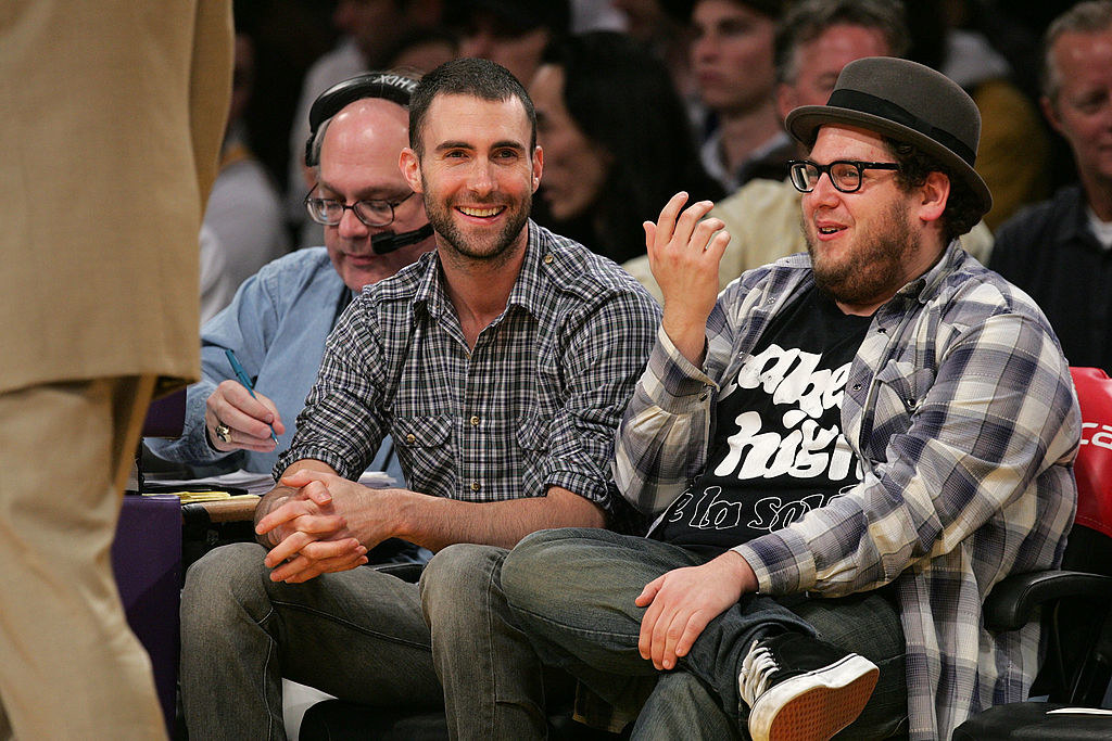 Adam Levine and Jonah Hill sitting court-side at a Lakers game in 2008