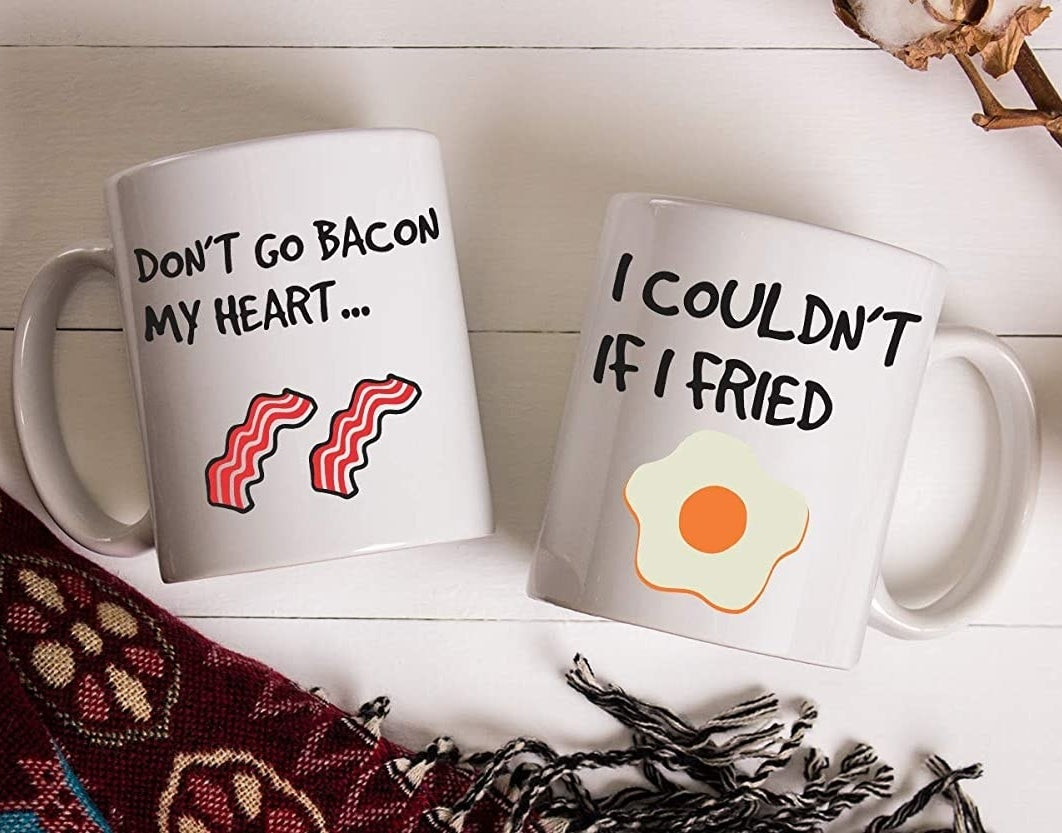 """A set of matching mugs: one says """"don't go bacon my heart"""" and the other says """"I couldn't if I fried"""""""