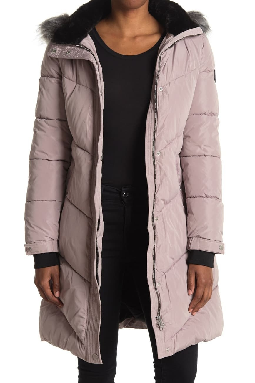 a model in a pink parka