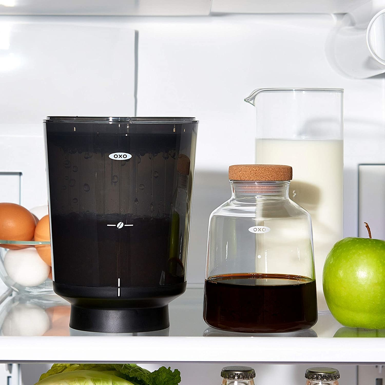 The coffee maker on a shelf in a fridge