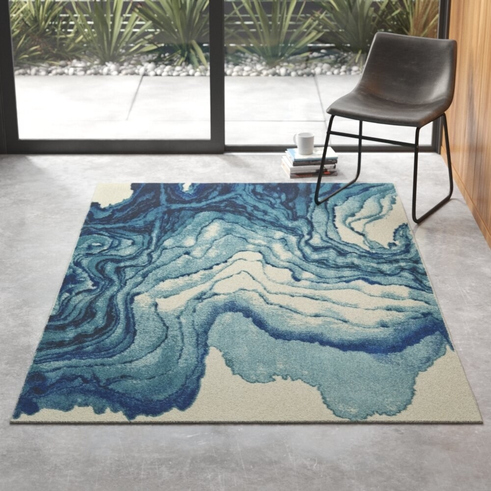 The rug on the floor of a room