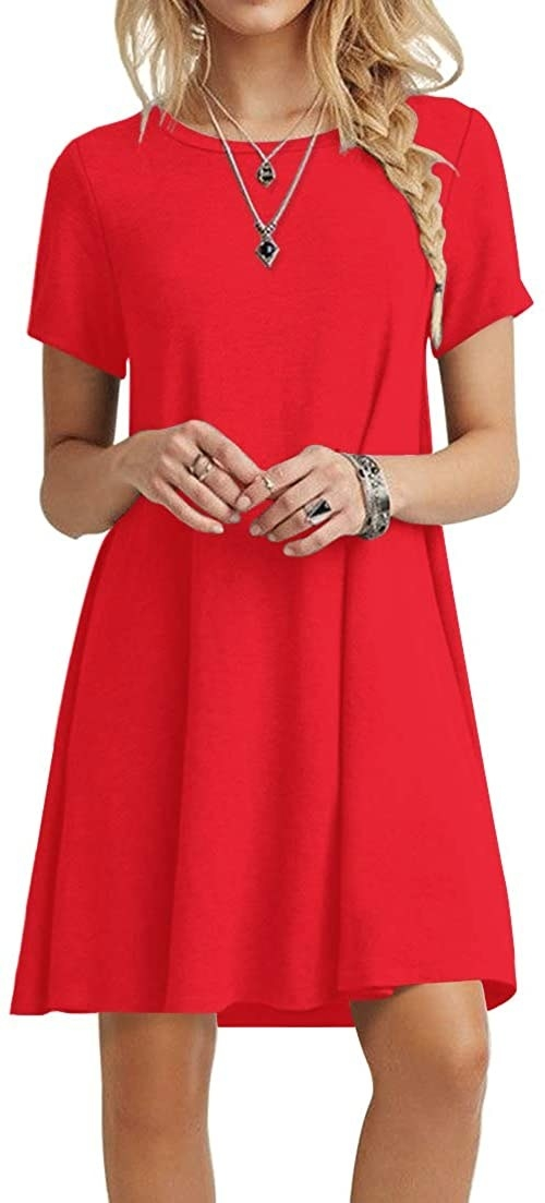 A model wearing the T-shirt dress in red.