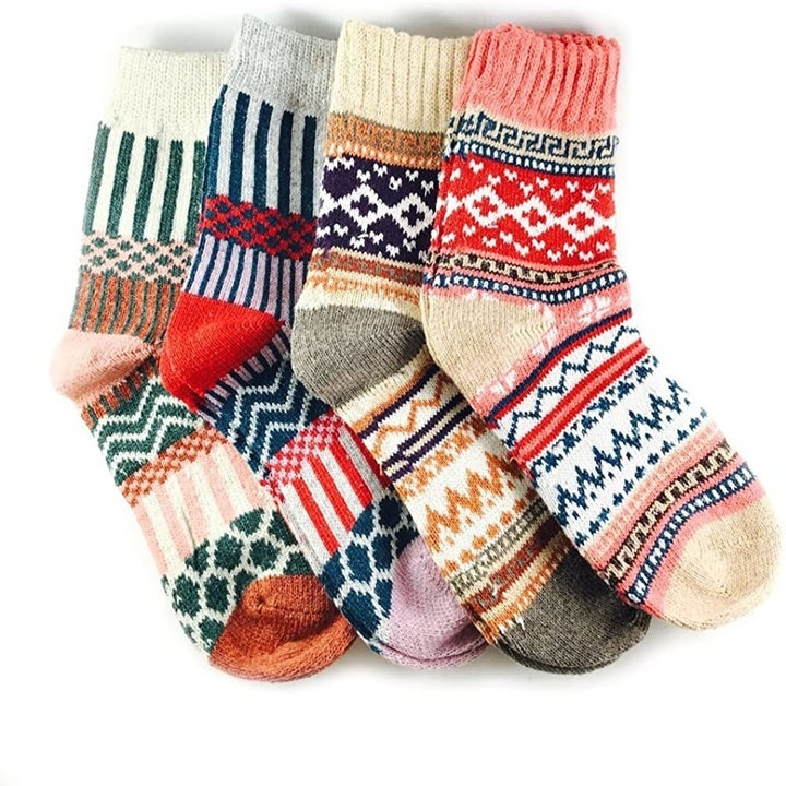 four different patterned crew socks