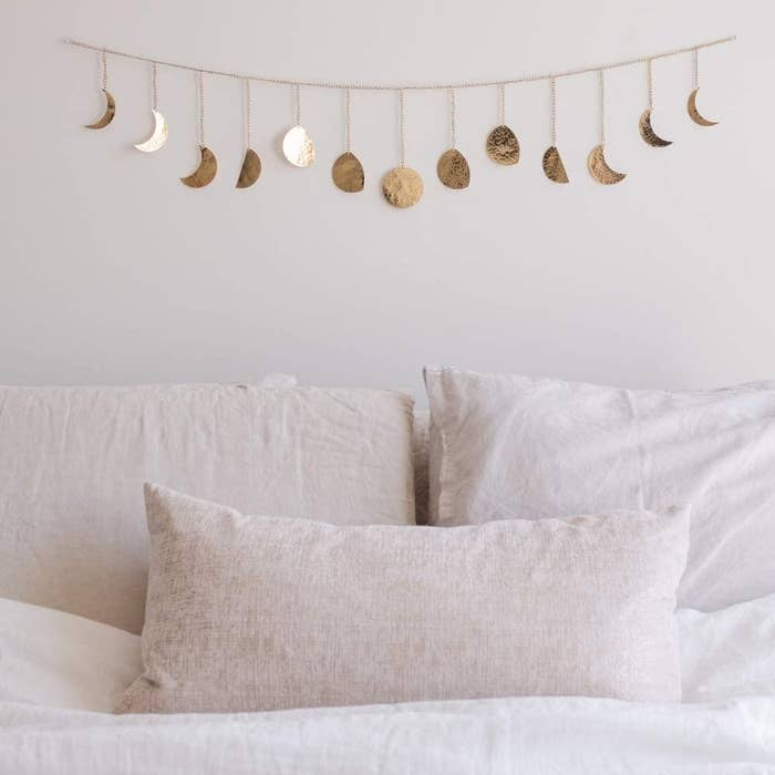 The garland hanging on a wall over a bed
