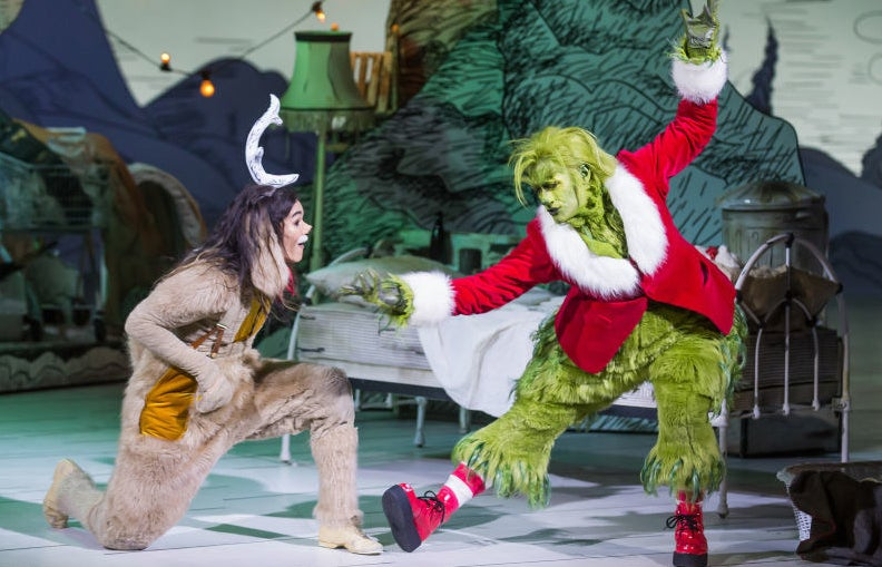 Matthew Morrison as the Grinch dancing and Booboo Stewart as Max the dog listening to him sing.
