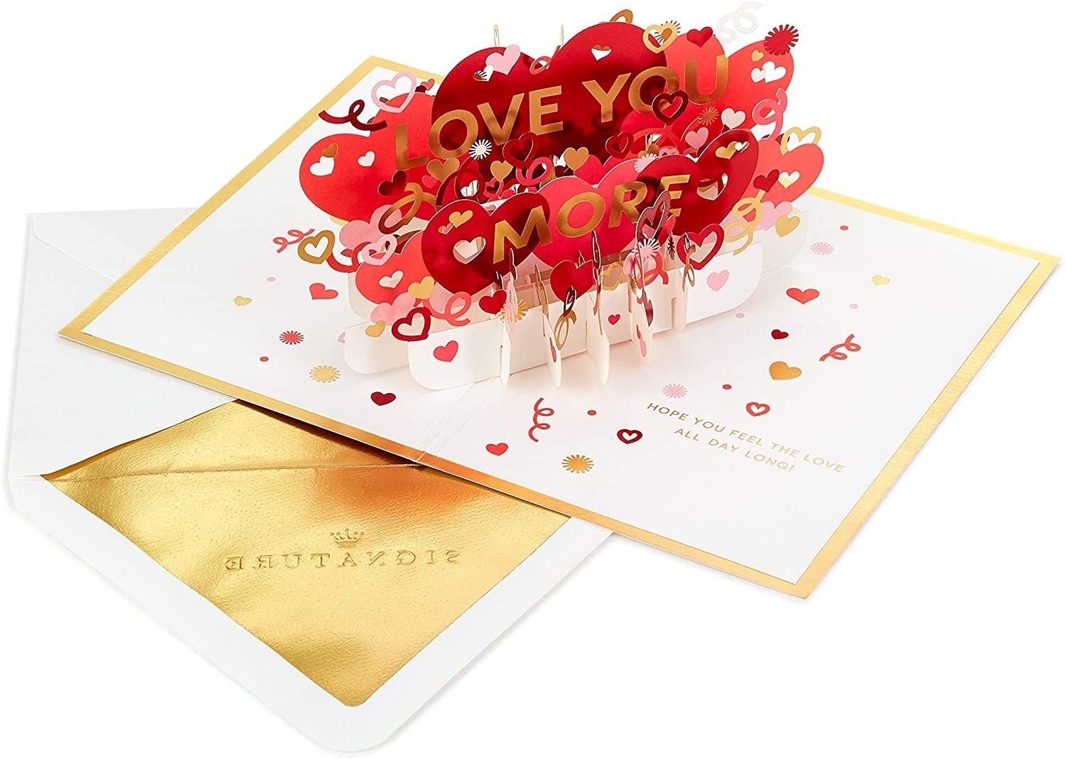 a card with a pop-up of the saying love you more