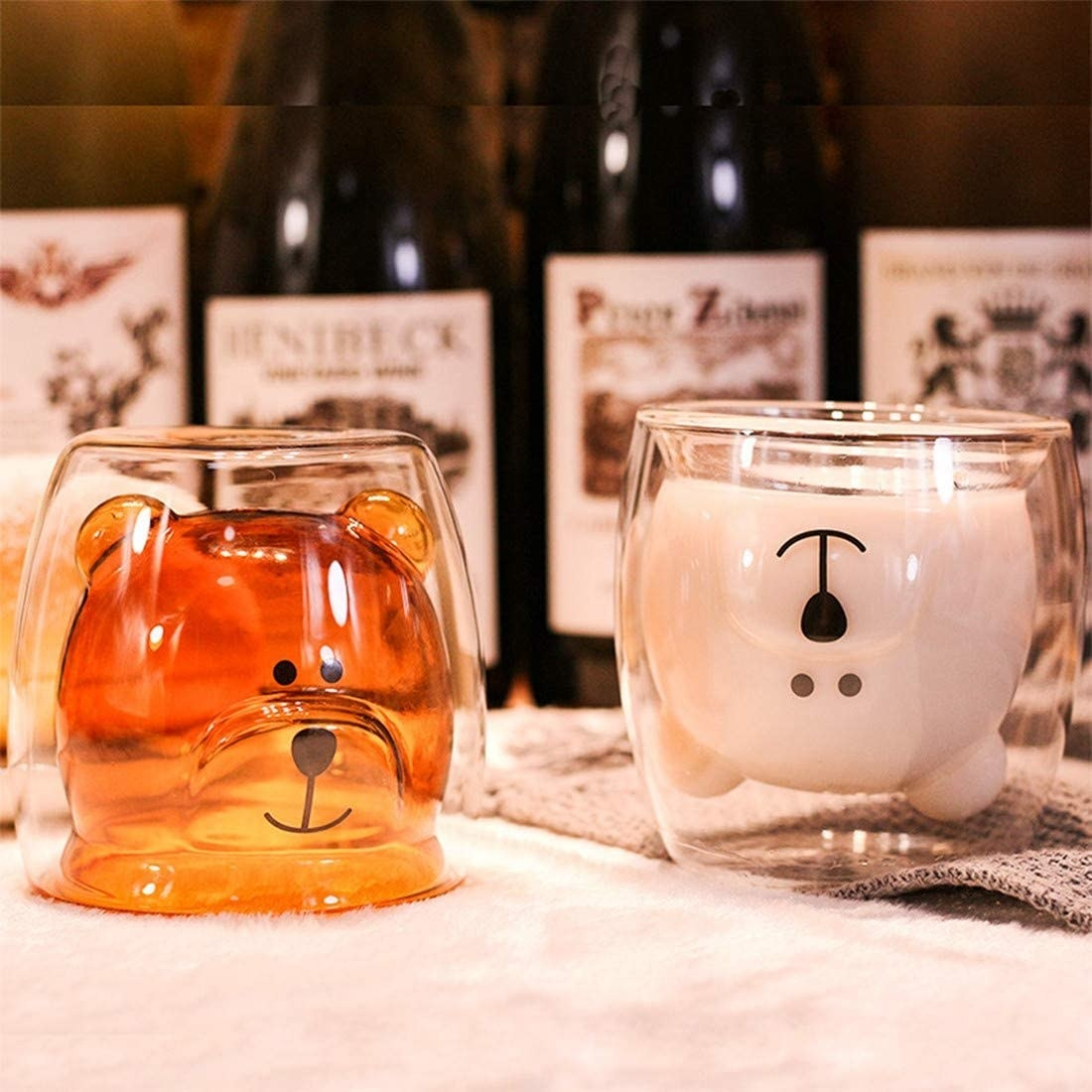 a glass mug with a bear inside of it that fills in with color when you pour a liquid in