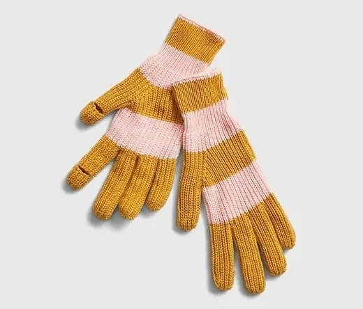 Multicolored gloves on white background