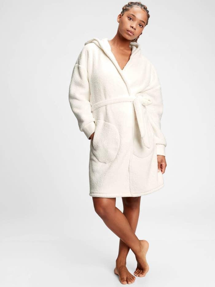 Model wearing robe