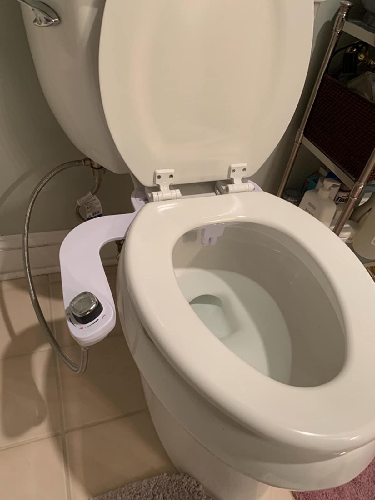 Reviewer photo of the bidet installed on their toilet