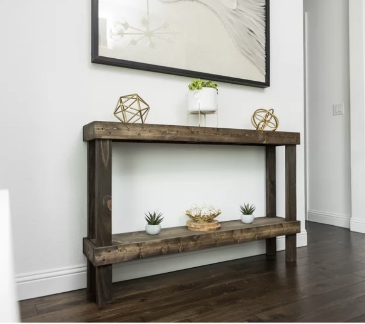 Dark wood console table with bottom shelf