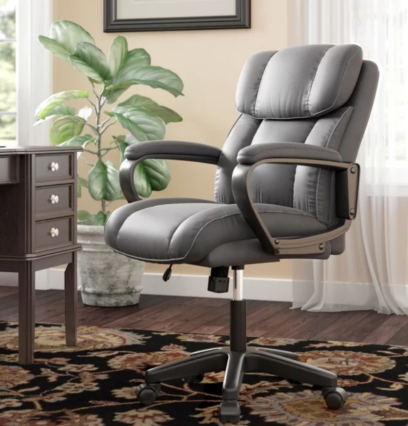 Gray padded swivel chair