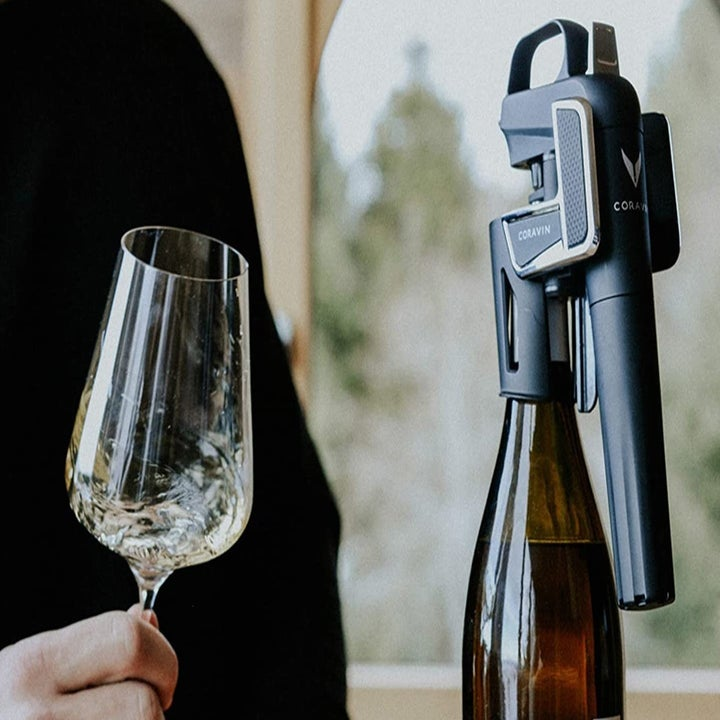 the wine preservation system attached to the top of a bottle