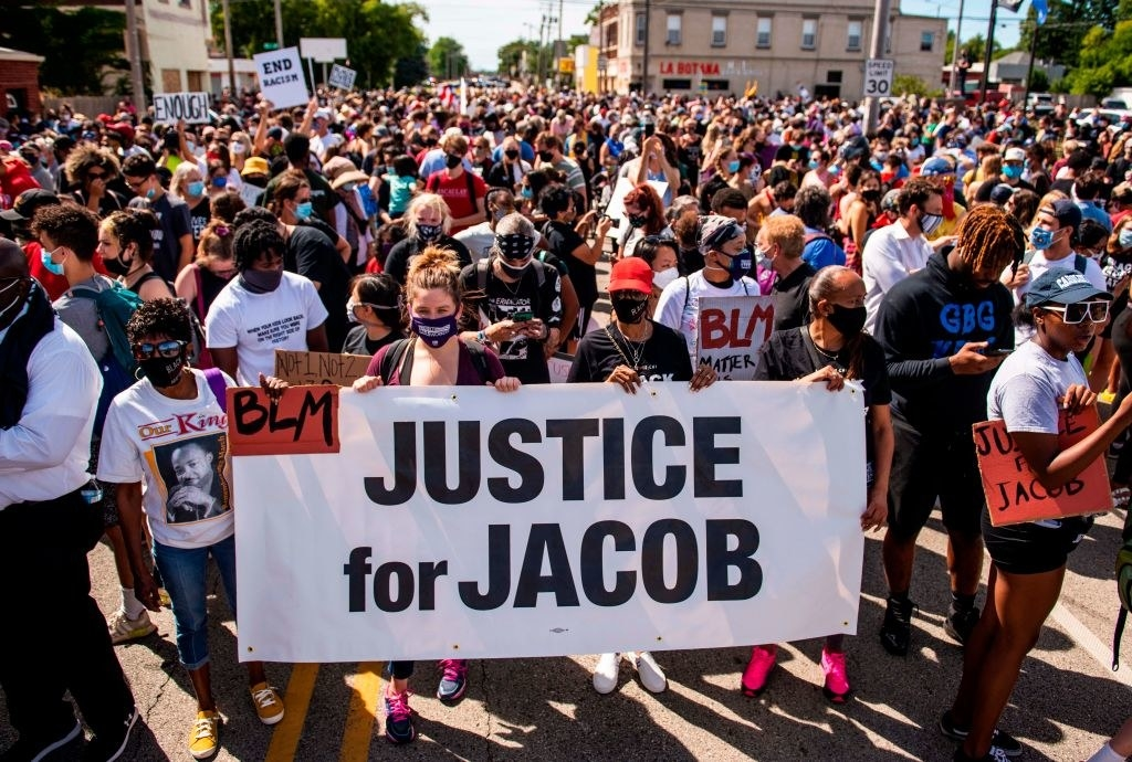 Protesters march with the family of Jacob Blake during a rally against racism and police brutality in Kenosha, Wisconsin, on August 29, 2020