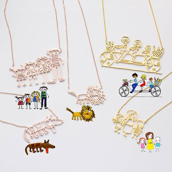 five different necklaces with the original kids' drawing right beside it. Two are gold and three are rose gold. Three are family drawings and two are drawings of animals.