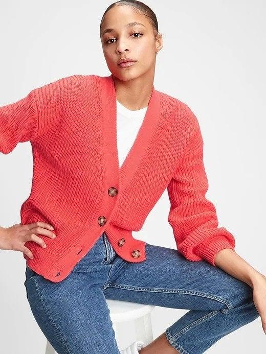 Model wearing pink cardigan