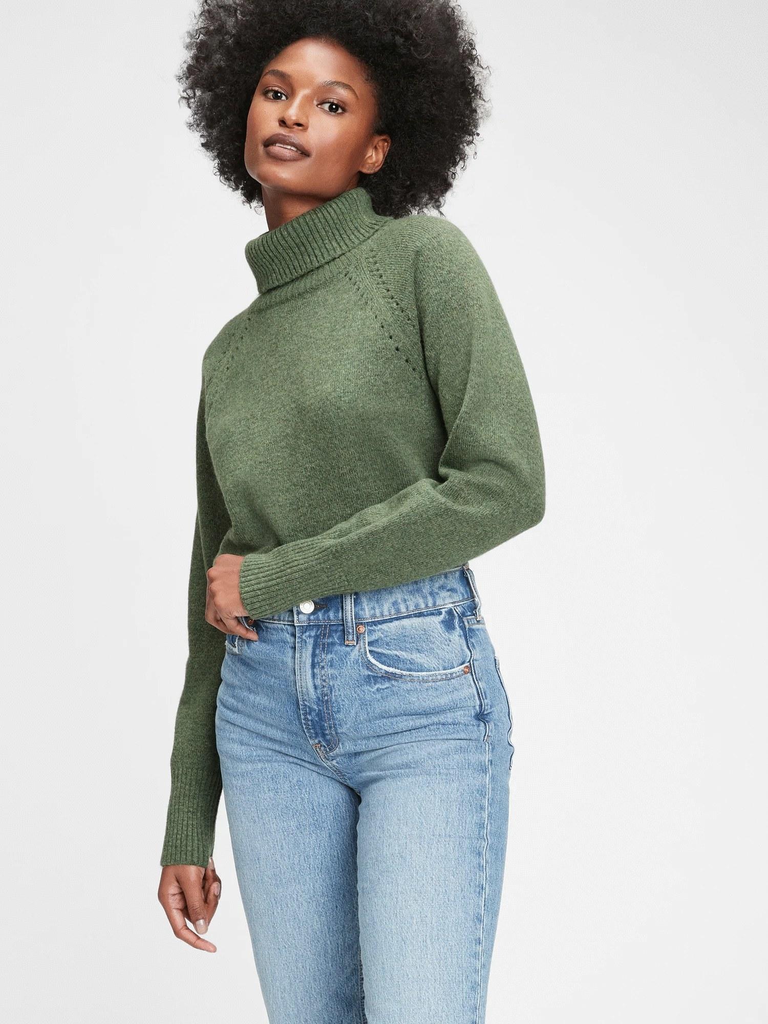 Model wearing green turtleneck sweater